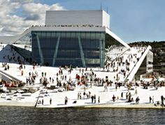Oslo Opera House - People love this cultural center so much that they come whether or not there is any production and stroll up the roof down the roof sit with feet in water.  There are no guard rails!!  Nothing to interfere with the beauty of the building!  In Norway they know that if they walk off the edge into the ocean it's their own fault!!!
