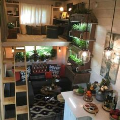Office Loft & Living Room - Ever Growing Tiny House The 330 sq. Ever Growing Tiny House features a custom wall garden with three planter boxes, an office loft, and a multifunction music room/guest bedroom. Tiny House Loft, Best Tiny House, Tiny House Living, Tiny House Plans, Tiny House On Wheels, Tiny House Design, Home Living Room, Inside Tiny Houses, Tiny Loft