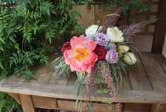 Organic garden design with Coral charm peony, Cool Water roses, purple heather, white tulips, red gerrondo gerberas and sivery willow eucalyptus foliage by Fleur de Vie.