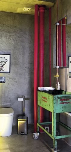 Loft bathroom. If you have exposed pipes, play them up! Love the industrial sink.