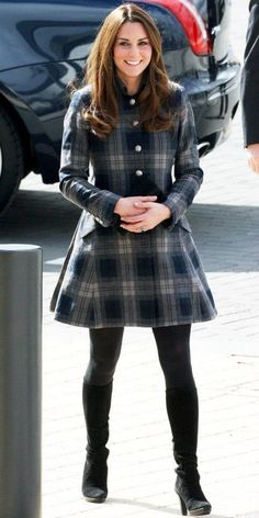 Flannel dress paired with black stockings and black fitted boots