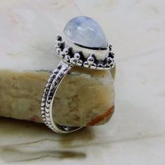http://jewelrybestdesign.com/product/rainbow-moonstone-tear-drop-ring-in-silver/  Rainbow Moonstone Tear Drop Ring in Silver  $42.00 This elegant ring is the ultimate display of the beauty that Rainbow Moonstone provides.  Perfect for a gift, this ring can bring a smile to the face of your loved ones.