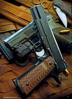 """gunsknivesgear: """" Dan Wesson Specialist. Notice the accessory rail on the underside of the slide, perfect for hanging a light or laser. """""""