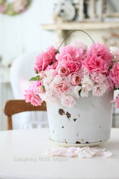 This would be absoultely beautiful on the tables in the Red Tin Barn www.redtinbarn.com  bucket of roses