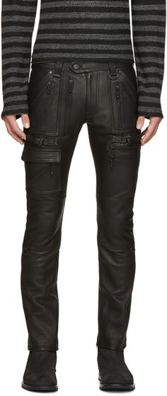 Skinny-fit grained leather biker pants in black. Six-pocket styling. Mock pockets with zip trim in black throughout. Decorative pin-buckle cinch straps at thighs.Zippered expansion panel at hem. Partially lined. Zip-fly. Tonal stitching.