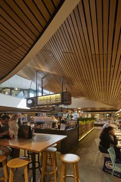 Undulating slatted timber ceiling a warm and welcoming feature in the new MLC Centre Food Court in Sydney. As part of the multi-million dollar redevelopment of one of Sydney's most iconic commercial towers, an extensive SUPAWOOD SUPASLAT slatted timber ceiling has been installed throughout the new Food Court. Photos Tyrone Branigan Productions