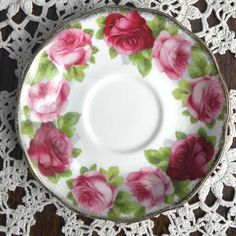 Old English Rose vintage tea saucer by Royal Albert potteries Pretty design of red and pink roses with the green leaf adores this fine bone china