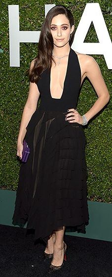 Emmy Rossum stunned in a black plunging Michael Kors dress, three pieces of De Beers jewerly, finished with a bright purple clutch.