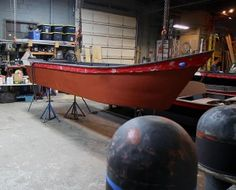 A guest boat that has been primed with an epoxy primer awaits finish painting.