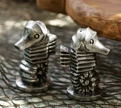 If we ever start cooking more at the beach!!!  Seahorse Salt & Pepper Shakers | Pottery Barn