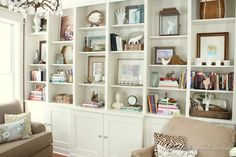 """""""Finding Home"""" gives us these Lessons Learned in Styling a Bookcase.  Read the whole thing to see how these tightly packed built-ins were edited for an airy, cohesive look (hint: limited palette of cream, wood, brass, and blue).  Pay special attention to how some shelves are layered, while others breathe freely with only one or two items."""