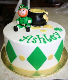 "Ashley's 18th - cake for a St. Patty's day birthday girl.  Took picture before ""Happy Birthday"" sign that leprechaun was supposed to be holding and additional clover was put on cake.  First time to make a figure ""person"" and I was quite happy with how I did.  TFL!"