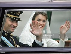 Princess of Asturias Letizia Ortiz and her husband Spanish Crown Prince Felipe of Bourbon salute the crowd aboard their Rolls Royce at the beginning of their parade in central Madrid 22 May 2004.