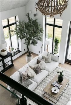 Bright contemporary living room design with neutral white, beige and black decor elements. Neutral living room decor, perfect for staging a home for sale or rental. white living room couch and black window trim in a contemporary design. Living Room Inspiration, Cool Living Room Ideas, Interior Design Inspiration, Decorating Ideas For The Home Living Room, Loving Room Ideas, First Apartment Decorating, Simple Living Room, Home Decor Inspiration, Interior Ideas