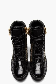 GIUSEPPE ZANOTTI //  Black Croc Embossed Leather High Top Sneakers  32266M050009  High top leather sneakers in black. Embossed croc print throughout. Round toe. Black lace up closure. Leather logo patch at tongue in black. Zip closures at eyerow with fang-shaped zipper pull in gold. Padded collar with leather trim. Black textured rubber foxing. Tone on tone stitching. Leather upper, rubber sole. Made in Italy.  $975 CAD