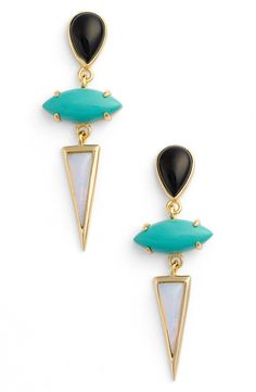 Contrast spikes suspend from a pair of colorful stones on modern earrings plated in gleaming 14-karat gold.