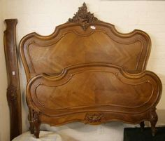 """Auction House: Kruger Gibbons Auctioneers & Valuers Date: Monday 02 September 2013 Bed - A Louis XV - style walnut bed frame, with original carved wooden side rails with quartered veneered panels C1900 64"""" wide, with hand carved details - superb example Estimate: £280.00 - £350.00"""