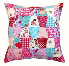 A tumbler patchwork pillow cover featuring the all of the cutest prints from Sarah Jane's fabric collection Children at Play for Michael Miller.  Red Pepper Quilts