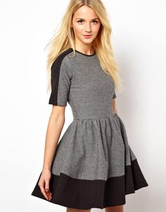Love this sweater dress. The flared skirt gives it such a girly vibe. It's perfect this season!