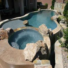 Bathroom:Neutral Tropical Pool Raised Spa Ho Tub Ideas With Stone Edging Also Small Creek Creative Ways To Beautifully Integrate An Hot Tub Decorating Ideas Tropical Pool, Tropical Landscaping, Swimming Pool Images, Swimming Pools, Piscina Spa, Round Hot Tub, Luxury Pools, Pool Builders, Custom Pools