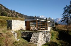 Shakti 360 leti - Uttaranchal Region, India. There are just four rooms perched high on a precipice with huge glass windows – perfect for panoramic mountain views and majestic stargazing – and a communal area with fine dining and a lovely fireplace.
