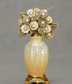 Andrea perfume bottle by Jay Strongwater  - I love that the flowers remind me of those cute little flowers you make with pipe cleaners and buttons.