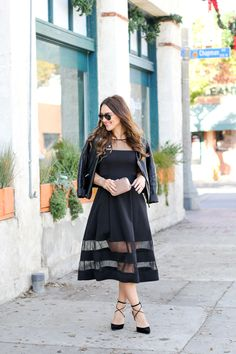 Dressing down a midi cocktail dress with a leather jacket and lace up pumps for a holiday party!