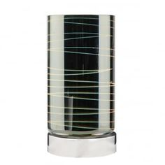 A modern cylindrical touch lamp with a black three dimensional glass shade on a polished chrome base. Perfect at a bedside, these would be ideal to add interest to kids and teenagers rooms. This light is double insulated, ensuring that it is safe to use in homes without an earth cable. This light is operated by a touch base, 3 stage dimmer (ensure that you choose dimmable bulbs).