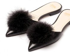Take a whirl in Pauline, hand crafted in cuoio leather, marabou-topped mules with stacked heel.