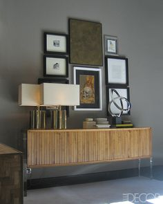 mid-century modern credenza, lamps, collage of wall art, this is magnificent