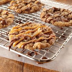 Caramel Sundae Cookies. Scrumptious chocolate chip and toffee cookies drizzled with caramel and chocolate!