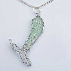 Mermaids tail seaglass pendant: https://www.seaglasssecrets.com/?product=mermaids-tail-pendant