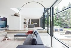 This two-story modern property is situated on a wooded lot in Oakville, Ontario, Canada designed by architect Guido Costantino. Sunken Living Room, Living Room Grey, Living Area, Living Spaces, Minimalist House Design, Minimalist Home, Minimal Design, Split Level Home Designs, Arco Floor Lamp