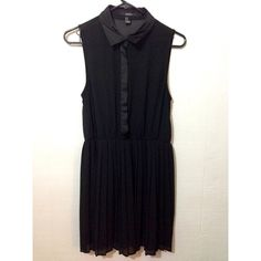 Black chiffon pleated dress Chiffon black dress with a pleated skirt. Has a layer that covers the buttons, lining that covers the buttons is a satin material. Worn once, like new! Forever 21 Dresses