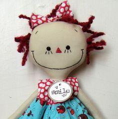 This makes me smile!  Annie in a Robin Dress handmade cloth rag doll, via Etsy.