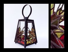 Dimensions: 9x5x5 For use with flameless candle only.  This stained glass lantern evokes the vibrant colours of the fall season. The combination of transparent and semi-opaque glass ensures that the colours remain vibrant even when the lantern is unlit. However, when darkness descends and the lantern is lighted, it produces a warm glow. A perfect contrastto chilling temperatures outside.