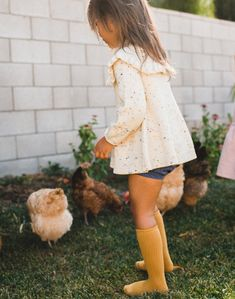SALE - Only a couple left of these Misha and Puff Ruffle Tunic Dress in Confetti Cake. Grab yours before they're gone forever! Little girl is shown wearing her tunic with Gray Label long ribbed socks in mustard and indigo bloomers courtesy of Billie Blooms. All available on the shop now!