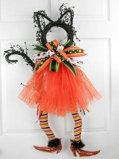 Who can resist a cute little Halloween black cat??? Well, prepare for major cuteness with this little kitty filled with black gypsum berry garland. Topped off with an orange cosmic twist tutu, fabulou