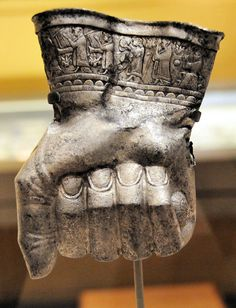 Hittite silver ceremonial drinking vessel in shape of fist (14th century BC). Along the cuff is inlaid a procession of musicians. On display at MFA, Boston
