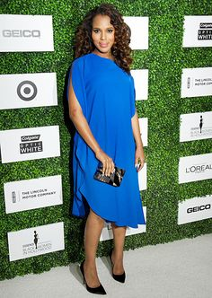 Kerry Washington wears a blue silk Calvin Klein Collection dress to the Essence luncheon on Feb. 27