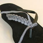 With Flare: Strips of decorative ribbon are braided together then attached to the thong part with hot glue.