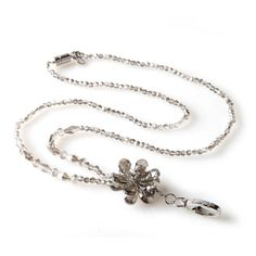 The Moonflower is a true treat for those who love to accessorize. Clear beads in various shapes make up the body of the piece and a large crystal floral accent adds stylish flair. Wear the Moonflower as a fashion lanyard during the day and then as a statement necklace in the evening by simply removing the hook attachment.