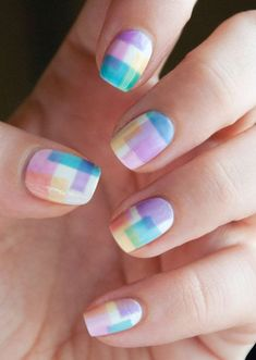 Watercolor checkered nail art design. Paint on checkered print nails in light strokes to achieve the watercolor style. This nail art tends to look very pretty and detailed.