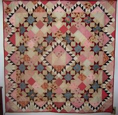 """Julie Charley Lofurno: It is a romantic design called """"Elizabeth"""" by Carrie L. Nelson from """"Miss Rosie's Splice of Life Quilts"""" it has 20+ fabrics  I hand-quilted it with simple horizontal and vertical lines.""""  """"24 Blocks"""" 07.08.14 NO PATTERN"""
