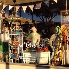 Avocado Festival came to town and window at Whimsy featured our avocado man scarecrow !