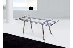 Mesa de comedor con tapa de cristal extensible.