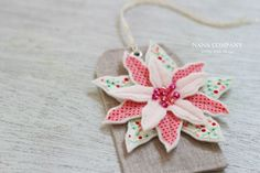 Stunning poinsettia gift tag from cotton and felt by Nana Company.  Her stuff is so beautiful!