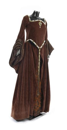 Glenda Jackson as Elizabeth I from Elizabeth R,1971, a rust coloured gown, of patterned velvet, edged with gold braid and pearl and jewel effect beads, having large turned back cuffs, revealing watered silk lining, and further lace sleeves, with boned bodice and laced back, together with a kirtle forepart of brown silk effect fabric with orange embroidered design