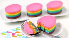 Egg-shaped cheesecakes with layers of rainbow colors.