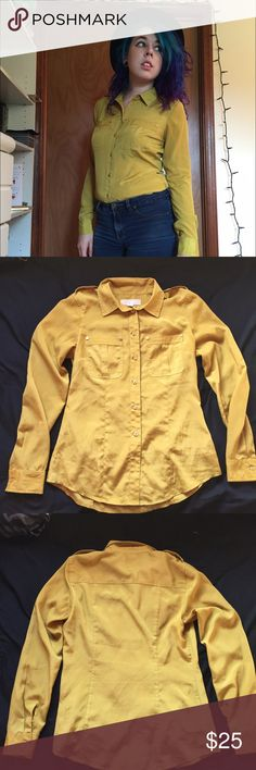MK Mustard Button Up Blouse EUC. Mustard yellow button up blouse by Michael Kors. Golden ML buttons. 100% polyester. Business / casual / professional / career .  If you need more info, don't hesitate to ask! ❌No trades.  ❌No holds. Michael Kors Tops Button Down Shirts